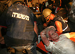 A man is rescued from the rubble at the site of a Hezbollah rocket attack in the northern Israel coastal town of Haifa Sunday Aug. 6, 2006. Hezbollah rockets crashed into the port city of Haifa Sunday, killing three people, in a heavy barrage that crushed buildings and caused dozens more casualties, police said JINI/MICHELL DOT COM/EPA