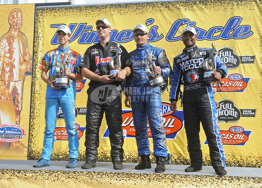 May 15, 2011; Commerce, GA, USA: NHRA pro category winners (right to left), Antron Brown (top fuel dragster), Jack Beckman (funny car), Jason Line (pro stock) and L.E Tonglet (pro stock motorcycle) at the Southern Nationals at Atlanta Dragway. Mandatory Credit: Mark J. Rebilas-