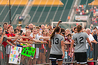 Fans look for autographs as Portland Thorns forward Alex Morgan (13) and forward Christine Sinclair (12) head out for warmups. The Portland Thorns defeated the Western New York Flash 2-0 during the National Women's Soccer League (NWSL) finals at Sahlen's Stadium in Rochester, NY, on August 31, 2013.