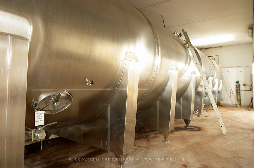 Domaine du Mas de Daumas Gassac. in Aniane. Languedoc. Unusual horisontal tank for assemblage. Stainless steel fermentation and storage tanks. France. Europe.
