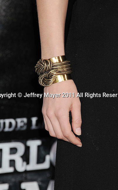 WESTWOOD, CA - DECEMBER 06: Amber Heard (bracelet detail) at the Los Angeles premiere of 'Sherlock Holmes: A Game Of Shadows' at Regency Village Theatre on December 6, 2011 in Westwood, California.
