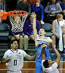 SIOUX FALLS, SD - MARCH 9:  Trae Vandeberg #3 from Dakota Wesleyan takes the ball to the basket over Aziz Leeks #22 from the College of Idaho during their second round game at the 2018 NAIA DII Men's Basketball Championship at the Sanford Pentagon in Sioux Falls. (Photo by Dick Carlson/Inertia)