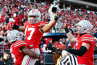 Ohio State Buckeyes running back Jalin Marshall (17) celebrates with Ohio State Buckeyes running back Ezekiel Elliott (15) and Ohio State Buckeyes tight end Jeff Heuerman (5) after one of his touchdowns in the fourth quarter of the college football game between the Ohio State Buckeyes and the Indiana Hoosiers at Ohio Stadium in Columbus, Saturday afternoon, November 22, 2014. The Ohio State Buckeyes defeated the Indiana Hoosiers 42 - 27. (The Columbus Dispatch / Eamon Queeney)