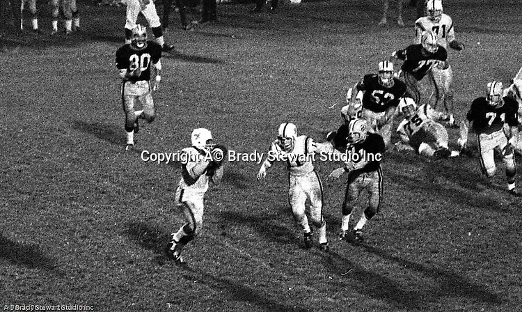 Bethel Park PA:  Offensive play with Mike Stewart 11 pitching the ball to Chip Huggins 32 on an option play.  Others in the Photo; Joe Barrett 75, Glenn Eisaman 71.  The offense and defense did not play well in the 12-6 defeat vs Montour. Montour's quarterback, Jim Daniels, killed the Blackhawks.  Jim Daniels was played his college ball at Pitt.  The defensive unit was one of the best in Bethel Park history only allowing a little over 7 points a game.
