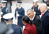 United States President Donald Trump smiles as Former President of the United States Barack Obama smiles at Michelle Obama as they stand on the east front steps of the Capitol Building after Trump is sworn in at the 58th Presidential Inauguration on Capitol Hill in Washington, D.C. on January 20, 2017.  <br /> Credit: John Angelillo / Pool via CNP