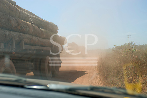 Mato Grosso State, Brazil. Logging trucks on the MT322 (BR080) road.