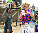 Brooklyn, New York, USA. 10th August 2013. BOB YORBURG, AKA Professor Phineas Feelgood, The World's Greatest Magician in the World, entertains visitors at the 3rd Annual Coney Island History Day celebration.