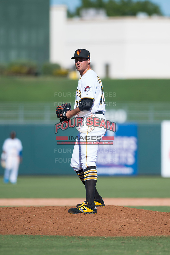Surprise Saguaros relief pitcher Geoff Hartlieb (70), of the Pittsburgh Pirates organization, gets ready to deliver a pitch during an Arizona Fall League game against the Salt River Rafters on October 9, 2018 at Surprise Stadium in Surprise, Arizona. Salt River defeated Surprise 10-8. (Zachary Lucy/Four Seam Images)