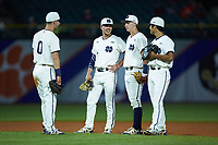 (L-R) Jake Shepski (0), Cole Daily (6), Nick Podkul (7) and Daniel Jung (31) get together during a pitching change in the game against the Louisville Cardinals in Game Eight of the 2017 ACC Baseball Championship at Louisville Slugger Field on May 25, 2017 in Louisville, Kentucky. The Cardinals defeated the Fighting Irish 10-3. (Brian Westerholt/Four Seam Images)