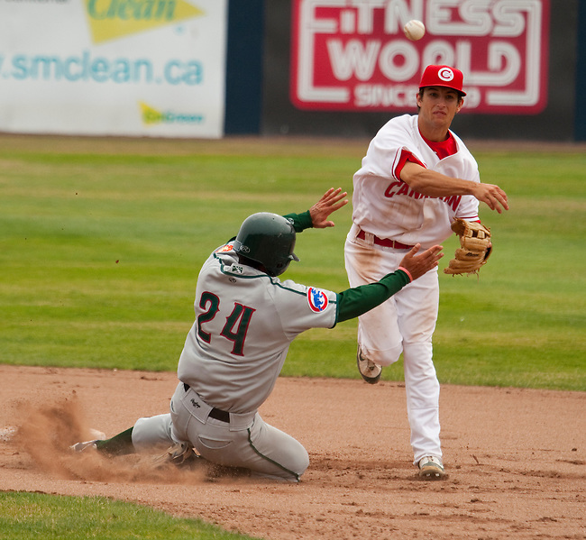 Tuesday, July 14, 2009.  Vancouver 2nd baseman Conner Crumbliss (right) throws to 1st  for the double play with one out in the 7th inning . Out at 2nd is # 24 George Matheus, out at 1st Matt Williams. Vancouver went on to win the game 3-2 at Nat Bailey Stadium in Vancouver.   Photo by Gus Curtis.