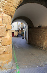 Alleyway entrance into housing area in old town centre of Cadiz, Spain