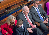 Former United States Vice President Dick Cheney, center, sits with his daughter, US Representative Liz Cheney (Republican of Wyoming), left, as they listen to the speeches on the floor of the US House of Representatives on the first day of the 115th Congress in the US Capitol in Washington, DC on Tuesday, January 3, 2017.  Ms. Cheney was elected in November 2016 to the seat formerly held by her Dad.<br /> Credit: Ron Sachs / CNP<br /> (RESTRICTION: NO New York or New Jersey Newspapers or newspapers within a 75 mile radius of New York City)