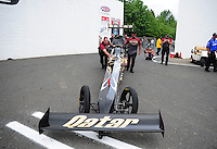 Jun. 1, 2012; Englishtown, NJ, USA: NHRA crew members for top fuel dragster driver Khalid Albalooshi push him up around the corner toward the starting line during qualifying for the Supernationals at Raceway Park. Mandatory Credit: Mark J. Rebilas-