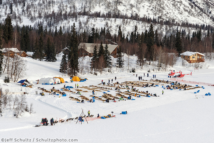 A team checks in as others rest on the lake at the Finger Lake  checkpoint during Iditarod 2016.  Alaska.  March 07, 2016.  <br /> <br /> Photo by Jeff Schultz (C) 2016 ALL RIGHTS RESERVED