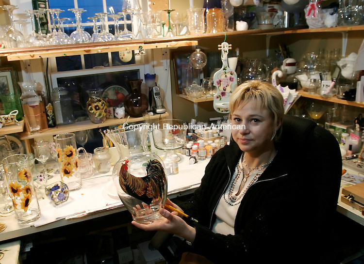 TORRINGTON, CT. 09 MARCH 2006- 030906BZ03- Artist Irena Varecka poses in her home studio holding a glass vase she painted. <br /> Jamison C. Bazinet Republican-American