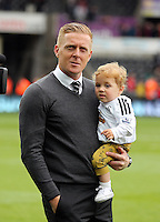SWANSEA, WALES - MAY 17: Swansea manager Garry Monk with one of his children after the Premier League match between Swansea City and Manchester City at The Liberty Stadium on May 17, 2015 in Swansea, Wales. (photo by Athena Pictures/Getty Images)