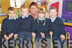 Dylan Flynn, Dan Dwyer, Tegan Kingdon, Mattie Howart, Douglas National School, Killaorglin, with teacher Delores Johnston, during their first day at school on Monday.............................................................................................................