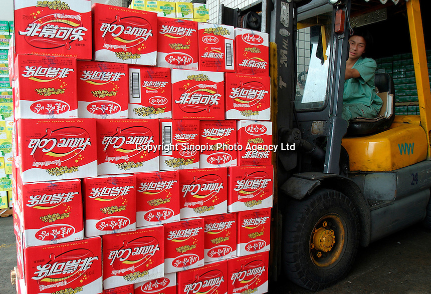 A fork lift carries a crate-full of Future Cola cases at the Wahaha Beverage Manufacturing Base in Hangzhou, China. The privately owned Wahaha group is the largest beverage manufacturer in China with a total production of 3.75 million tons in assorted beverages last year. The group has recently decided to ship nearly 15 thousand cases of its Future Cola to the U.S..07-JUN-04