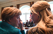 German Chancellor Angela Merkel (L) speaks with Ivanka Trump during a roundtable discussion on vocational training with United States and German business leaders in the Cabinet Room of the White House in Washington, DC on March 17, 2017.        <br /> Credit: Photo by Pat Benic / Pool via CNP