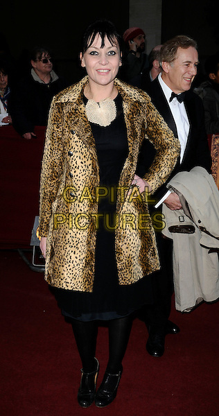 PEARL LOWE .at the Galaxy British Book Awards, Grosvenor House Hotel, Park Lane, London, England, UK, April 3rd 2009..full length leopard print coat hand on hip black tights dress t-bar shoes mary janes .CAP/CAN.©Can Nguyen/Capital Pictures