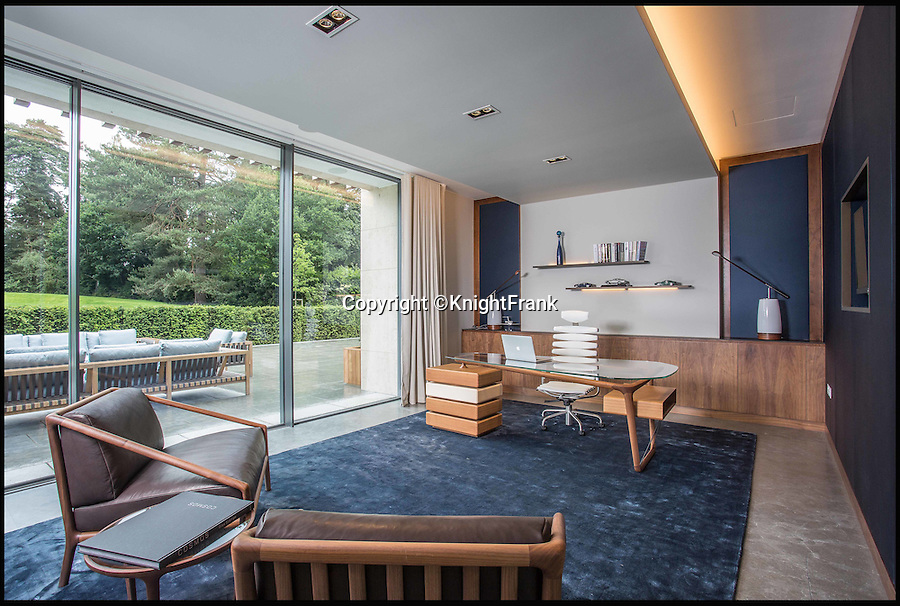 BNPS.co.uk (01202 558833)<br /> Pic: KnightFrank/BNPS<br /> <br /> A stunning contemporary property on the famous  Wentworth estate will make golf fans green with envy after going on the market for £25m. <br /> <br /> The luxurious home is a stone's throw from the internationally renowned golf course's 12th fairway where players like Rory McIlroy and Colin Montgomery play every year. <br /> <br /> The lucky buyer won't have to worry about being struck by stray balls though as the property sits in five acres of private woodland. <br /> <br /> Notable residents of the exclusive estate include Bruce Forsyth and Prince Naseem Hamed while Elton John and Cliff Richard have previously inhabited the area.