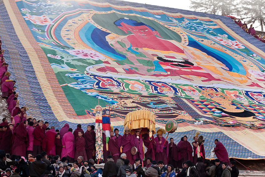 This Great Thangka of Buddha Shakyamuni is being displayed on the sacred hill in front of the monastery. With more pilgrims than ever and more policemen and soldiers than ever...