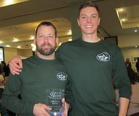NWA Democrat-Gazette/CARIN SCHOPPMEYER Travis McKenna (left) and Alex accept the Partners + Prevention Award on behalf of Little Guys Movers.