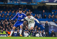 Goalscorer Diego Costa of Chelsea & Adrien Rabiot of Paris Saint-Germain battle during the UEFA Champions League Round of 16 2nd leg match between Chelsea and PSG at Stamford Bridge, London, England on 9 March 2016. Photo by Andy Rowland.