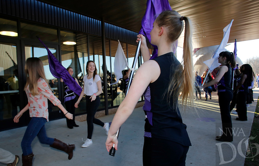NWA Democrat-Gazette/DAVID GOTTSCHALK - 1/27/15 - Deborah Koch, center, Fayetteville High School junior and color guard member, greets Eighth grade students from Fayetteville Public Schools Tuesday January 27, 2015 as they arrive at Fayetteville High School. The district is beginning to transition the students to become the first freshmen class at the high school. The students were met by the marching band, color guard and cheerleaders before spending the day in orientation which included an introduction to advance placement classes, introduction to the varying schedules and lunch in the cafeteria.