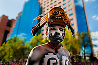 A Mexican man, wearing a colorful feather mask inspired by Aztecs, takes part in the Day of the Dead parade in Mexico City, Mexico, 29 October 2016. Day of the Dead (Día de Muertos), a syncretic religious holiday combining the death veneration rituals of the ancient Aztec culture with the Catholic practice, is celebrated throughout all Mexico. Based on the belief that the souls of the departed may come back to this world on that day, people gather at the gravesites in cemeteries praying, drinking and playing music, to joyfully remember friends or family members who have died and to support their souls on the spiritual journey.