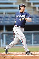 Rome Braves Hilton Richardson #15 swings at a pitch during  a game against  the Asheville Tourists at McCormick Field in Asheville,  North Carolina;  May 18, 2011. The Braves won the game 8-7.  Photo By Tony Farlow/Four Seam Images