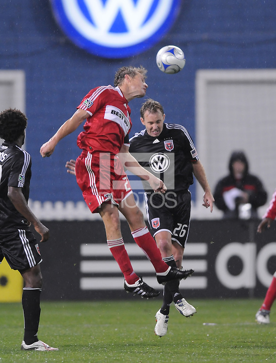 Chicago Fire forward Brian McBride (20) heads the ball over DC United defender Bryan Namoff (26). Chicago Fire tied DC United 1-1 at RFK Stadium, Saturday March 28, 2009.