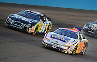 Apr 17, 2009; Avondale, AZ, USA; NASCAR Nationwide Series driver Michael Waltrip (99) reacts after contact with Carl Edwards (60) led to a crash during the Bashas Supermarkets 200 at Phoenix International Raceway. Mandatory Credit: Mark J. Rebilas-