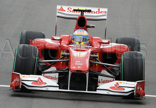 Spanish driver Fernando Alonso of Ferrari drives his car across the race track during qualifying at Spa-Francorchamps Circuit near Spa, Belgium