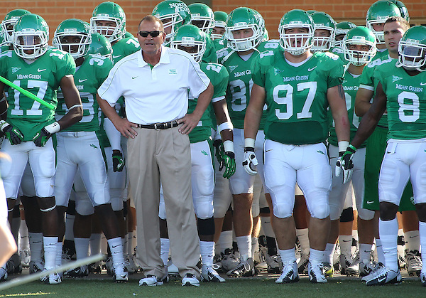 Denton, TX - NOVEMBER 3: Dan MaCarney head coach of the North Texas Mean Green waits with the team before taking the field against the Arkansas State Red Wolves at Apogee Stadium in Denton on November 3, 2012 in Denton, Texas. Photo by: Rick Yeatts