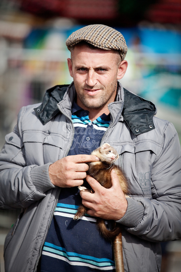 3/10/2010.  Martin Reily from Cabra Court, Thurles, County Tipperary and his ferrett  is pictured at the Ballinasloe Horse Fair, Ballinasloe, County Galway, Ireland. Picture James Horan