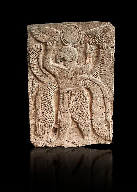 Pictures & images of the North Gate Hittite sculpture stele depicting a winged bird God. 8the century BC.  Karatepe Aslantas Open-Air Museum (Karatepe-Aslantaş Açık Hava Müzesi), Osmaniye Province, Turkey. Against black background