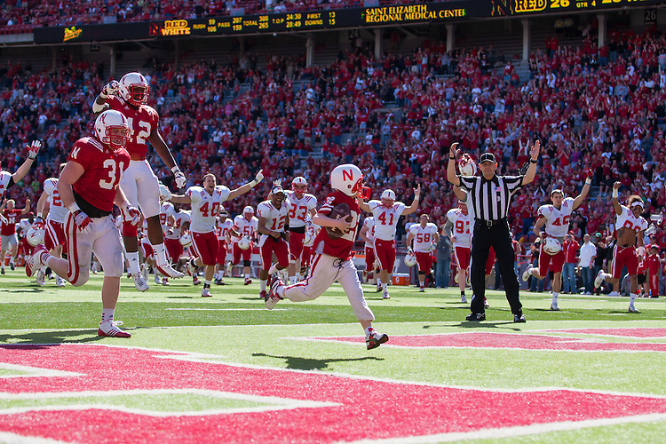 April 06, 2013: Seven year old Jack Hoffman #22 scores a touchdown in the fourth quarter for the Red team at Memorial Stadium in Lincoln, Nebraska. Jack has been battling brain cancer. The Red team defeated the White team 30 to 21. Photo John S. Peterson.