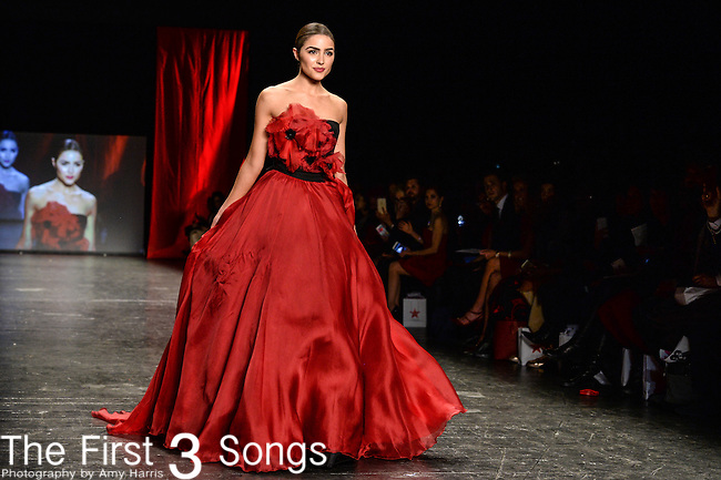 Olivia Culpo walks the runway during the American Heart Association's Go Red For Women Fashion Show at the Mercedes-Benz Fashion Week Fall 2016 in New York City.