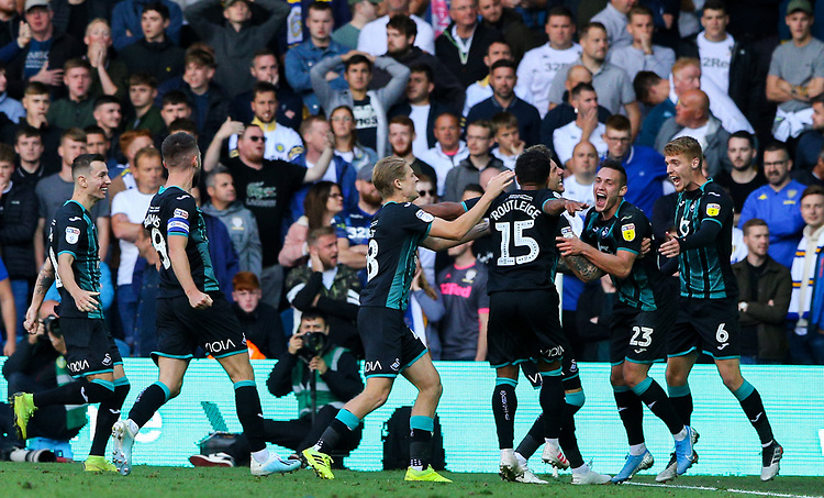 Swansea City's Wayne Routledge celebrates scoring the late winning goal with teammates<br /> <br /> Photographer Alex Dodd/CameraSport<br /> <br /> The EFL Sky Bet Championship - Leeds United v Swansea City - Saturday 31st August 2019 - Elland Road - Leeds<br /> <br /> World Copyright © 2019 CameraSport. All rights reserved. 43 Linden Ave. Countesthorpe. Leicester. England. LE8 5PG - Tel: +44 (0) 116 277 4147 - admin@camerasport.com - www.camerasport.com