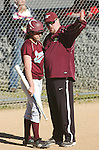 A Loyalsock Area  High School coach talks with a player before going to bat.