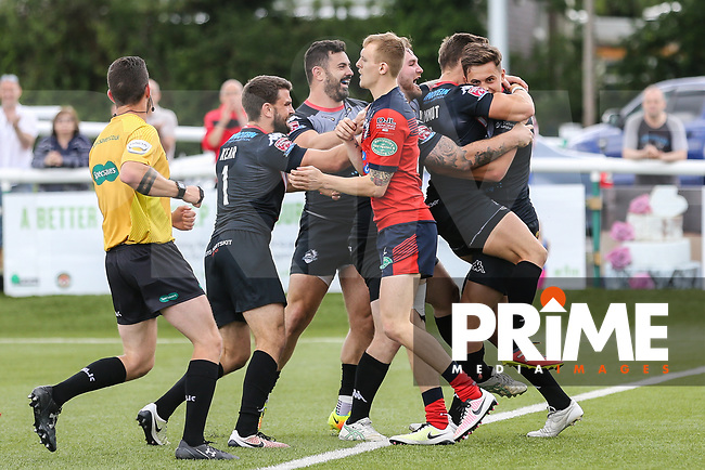 Alex Walker of London Broncos (right) celebrates with team mates after he scores a try during the Kingstone Press Championship match between London Broncos and Featherstone Rovers at Castle Bar , West Ealing , England  on 25 June 2017. Photo by David Horn.