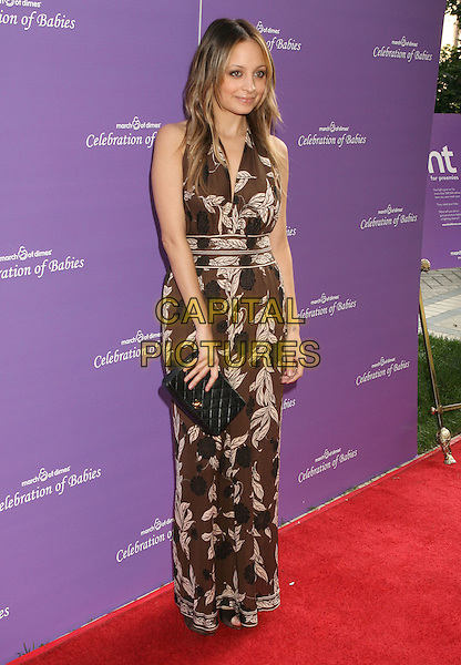 NICOLE RICHIE.attending the March of Dimes Celebration of Babies held at the Four Seasons Hotel,  Los Angeles, California, USA, 7th November 2009..full length long maxi brown pattern print dress chanel black clutch bag .CAP/ADM/MJ.©Michael Jade/Admedia/Capital Pictures