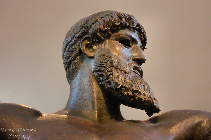 Statue of Poseidon at a museum in Athens
