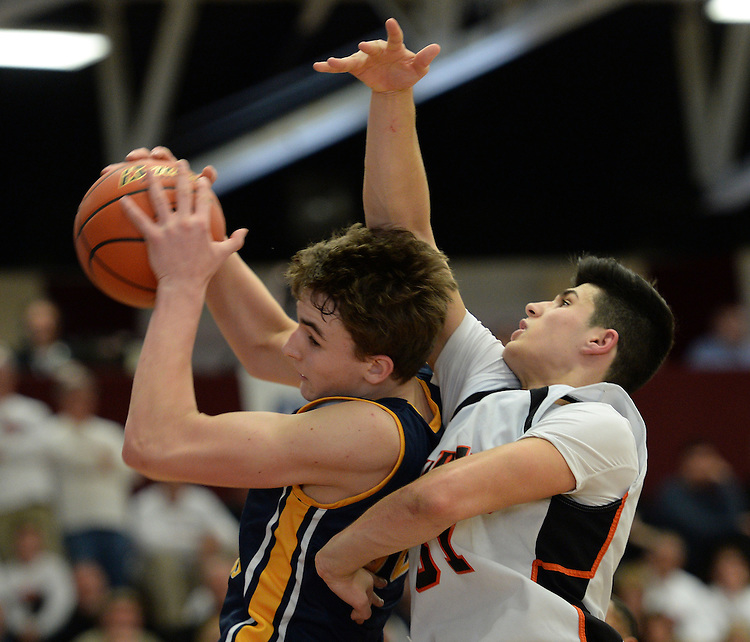 (Springfield, MA, 03/19/16) St. Mary's Matthew Cross, left, hauls in a rebound in front of Maynard's Joel Erickson during the fourth quarter of the Boys Division 4 state basketball final at Springfield College on Saturday, March 19, 2016. Staff photo by Christopher Evans