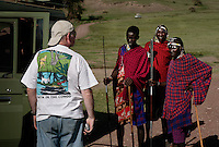 Crater Tourism:.Tanzania wants to boost the number of tourists to 1 million in ten years.  Right now there are about 300,000 tourists and 30,000 Masai.  The Masai homeland was Serengeti National Park... then they got thrown out of there and were all put in this crater... then they were all thrown out of the crater and this crater has become Tanzanias foremost tourist attraction.  The FZS people say the last 20 Rhinos in the crater may be reacting to this level of tourism... if it increases 3 to 4 fold it is hard to say what will happen.  More tourism also means more camps, more lodges and less land for Masai and their cattle..Also the lodges on the rim of the crater are sucking so much water that it is affecting the ecosystem.  Maasai are switching to smaller stock that can deal with drier conditions.   Even though the crater was their homeland, now they are only allowed to brind cattle in during the day to lick salt and then they have to leave.  But the more enterprising Maasai try to get money off tourists by selling their spears or posing for photographs.  This newfound wealth is creating a breakdown of the family system.  Where they used to get together in the forest for a meal with their extended families, now they have so few cows and everyone is out for themselves... so the money sucked off of tourism is spent on beer and cell phones.  The average Maasai now has 2 or 3 cows... the average in the 70's was 12 cows per Maasai.  In previous years, if a Maasai family lost cows, the rest of the community would get together and replace them... not anymore....  The Maasai were kicked out of Serengeti National Park.  Then they were kicked out of the crater which is now Tanzania's main tourist attraction. Now they feel like they are squatters on their land and might be kicked out of the NCA at any time.