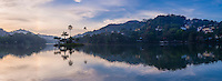 Panorama photo of Kandy Lake and the island at sunrise, Kandy, Central Province, Sri Lanka, Asia. This is a panorama photo of the island in the middle of Kandy Lake in Kandy at sunrise, Central Province of Sri Lanka, Asia. Kandy is the second largest city in Sri Lanka, and is home to beautiful Kandy Lake, a great place to visit for a walk at sunrise. The Sacred City of Kandy is one of eight UNESCO World Heritage Sites in Sri Lanka.