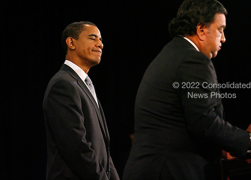 Chicago, IL - December 3, 2008 -- United States Secretary of Commerce designee and New Mexico Governor Bill Richardson (R) addresses reporters as United States President-elect Barack Obama stands by his side at news conference in Chicago on December 3, 2008. .Credit: Brian Kersey - Pool via CNP