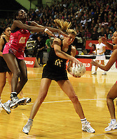 Sonia Mkoloma tries to intercept a pass to Irene van Dyk during the International  Netball Series match between the NZ Silver Ferns and World 7 at TSB Bank Arena, Wellington, New Zealand on Monday, 24 August 2009. Photo: Dave Lintott / lintottphoto.co.nz