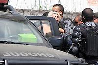 RIO DE JANEIRO, RJ ,22 DE MARCO DE 2013 - O BATALHÃO DE CHOQUE INVADIU A ALDEIA MARACANÃ - Policiais do batalhão de choque invadiu a Aldeia Maracanã nesta tarde e houve tumulto do lado de fora da Aldeia. A Avenida Maracanã chegou a ser interditada por uma hora e manifestantes entraram em confronto com a policia que desparou tiros de balas de borracha, e usou esplay de pimenta. Uma ativista da FEMEN conhecida como Sara tirou a blusa em protesto e foi detida pela policia. FOTO: SANDRO VOX/BRAZIL PHOTO PRESS